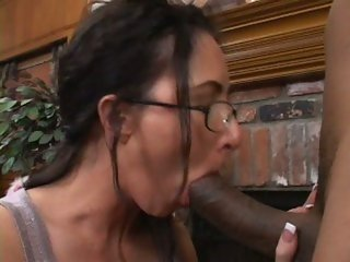 Katrina Isis has her glasses jizzed by a portion from a hard black cock shaft