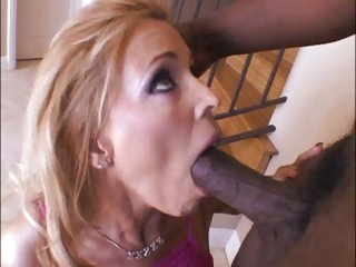 Sexy blonde milf Nicole Moore fits a pulsating dark pecker in her filthy mouth