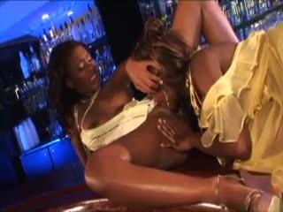 Glamorous black girls share a dildo