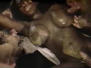 Black woman covered in cum