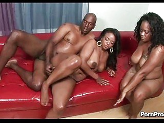 Chocolate hunk copulates two swarthy babes with big titties