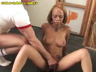 Ebony bitch is in a gangbang with white cocks and acquires bukkake