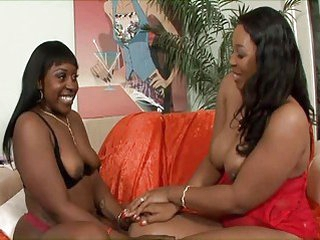 Black lesbian shares a massive Fake penis with her gf