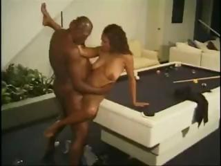 Breasty ebony Nikki licks a big dick and gets hammered by it