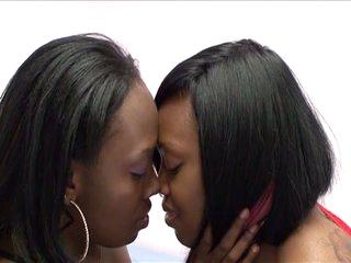 Horny ebony lesbians teasing wet cunts