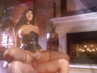 Dark haired pornstar in black corset gets dominated by shaved hunk