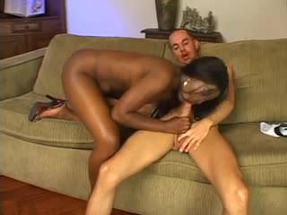 Curvaceous ebony babe fucks her submissive boy with strapon