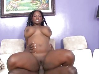 Chunky ebony girl rides on a thick black ramrod