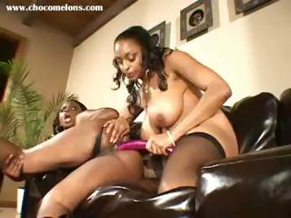 Busty ebony lesbians lick some pussy and use toys in the ass