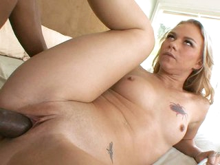 Melanie Jayne buries a massive darksome cock in her hot soaked pussy