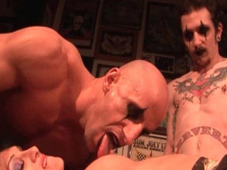 A tattooed chick gets banged hard by two guys