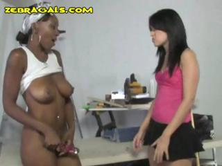 Nasty black bitch masturbates then gets joined by a sexy brunette