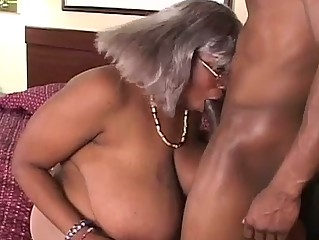 Bbw dark grandma gets a piece of hunk cock