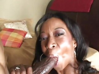 Stacey Money wraps her moist lips around a huge dick