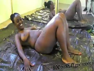 Ebony bitch with a huge ass stretches her oily body to get ready for the big darksome dong