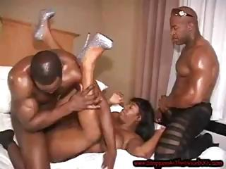 Two black fellows give it to this ebony girl and pound her for a facial