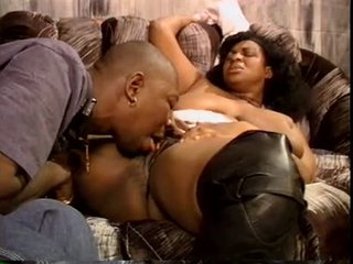 Horny dark BBW chick in leather boots blowjob