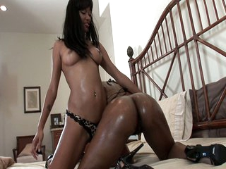 Asian and ebony lesbians toy and lick pussy