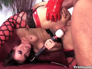 Dana Dearmond is a sexy dressed brunette in red and dark nylons that gets her butthole drilled by man in red latex gloves. She enjoys dick in the ass and vibrates her snatch at the same tie.