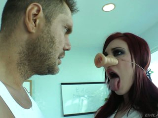 Redhead Andy San Dimas in fashionable white blouse and black skirt is a pg whore that gets down on her knees in front of Nacho Vidal. She gets her tongue out ready to gulp his sausage.